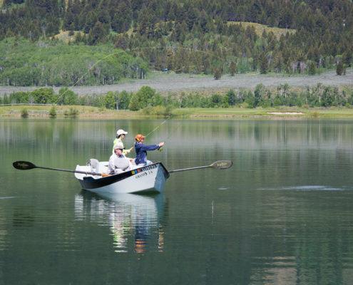 Fishermen float on a lake